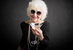Cool grandma havinga a drink Stock Images
