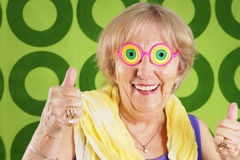 Cool grandma. Humorous cool grandmother with crazy glasses Stock Photo