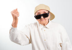 Cool grandma kicks with her fist Stock Images