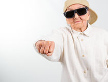 Cool grandma kicks with her fist Royalty Free Stock Photo