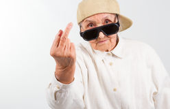 Cool grandma showing her f-finger Royalty Free Stock Images