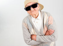 Cool grandma stands for her right. Funny grandma's studio portrait  wearing eyeglasses and baseball cap, who stands for her right,   on white Stock Photo