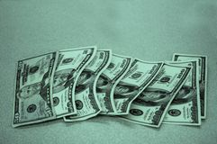 Cool Green Cash. American dollars, laid out on counter stock image