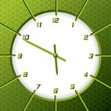 Cool green clock with hexagon background Stock Photos