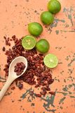 Cool limes and spicy hot dried red chili peppers Royalty Free Stock Photo