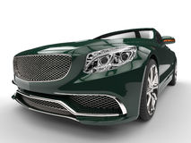 Cool green modern expensive car - headlight closep shot. On white background Royalty Free Stock Images