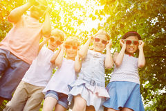 Cool group of kids as interracial friends Stock Image