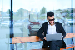 Cool guy arabic man uses laptop business center Royalty Free Stock Images