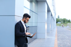 Cool guy arabic man uses laptop in business center Royalty Free Stock Image