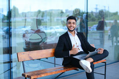 Cool guy arabic man uses laptop business center Stock Photos