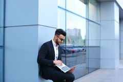 Cool guy arabic man uses laptop in business center Royalty Free Stock Photography
