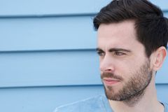 Cool guy with beard. Close up portrait of a cool guy with beard looking away Royalty Free Stock Image