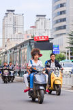 Cool guy on an e-bike in city center, Kunming, China Stock Photo