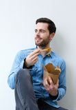 Cool guy eating chinese take away food Royalty Free Stock Photography