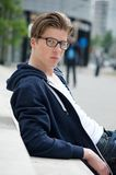 Cool guy with glasses. Close up portrait of a cool young guy with glasses posing outdoors stock photo