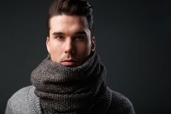 Cool guy with gray wool scarf Royalty Free Stock Photos