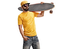 Cool guy holding a longboard Royalty Free Stock Photos
