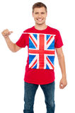 Cool guy with idea of UK flag on t-shirt Royalty Free Stock Image