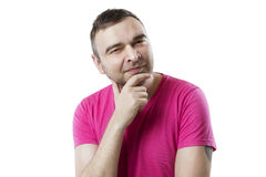 Cool guy looking at the camera with a sly Royalty Free Stock Photography