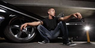 Cool guy next to his car Royalty Free Stock Images