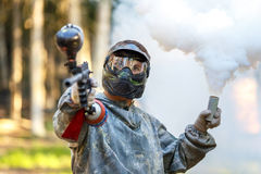 Cool guy with paintball gun and smoke grenade Royalty Free Stock Photos