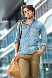 Cool guy posing with leather bag outside Royalty Free Stock Photo