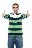 Cool guy showing double thumbs up to camera Royalty Free Stock Image