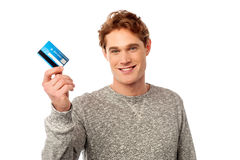 Cool guy showing his credit card Stock Photos