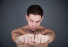 Cool guy shows his strong hands Royalty Free Stock Photography