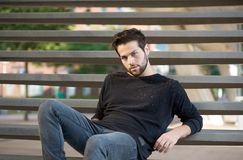 Cool guy sitting on steps outdoors. Portrait of a cool guy sitting on steps outdoors Stock Photo