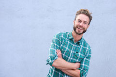 Cool guy smiling with arms crossed Stock Images