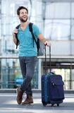 Cool guy smiling with bags at airport Stock Photography