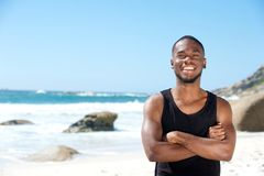 Cool guy smiling at the beach Stock Photography