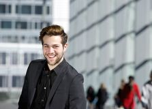 Cool guy smiling in black business suit Royalty Free Stock Photos