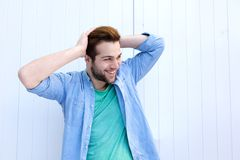 Cool guy smiling with hand in hair royalty free stock images