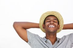 Cool guy smiling with hands behind head Stock Photography