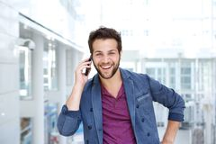 Cool guy smiling with mobile phone Stock Photo