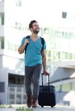 Cool guy smiling with suitcase and bag Stock Photography