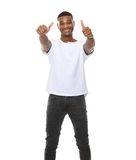 Cool guy smiling with thumbs up sign Royalty Free Stock Photography