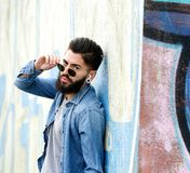 Cool guy with sunglasses listening to music with earphones Royalty Free Stock Photo