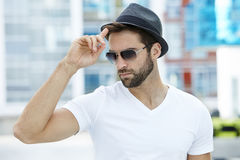 Cool guy. With sunglasses tipping hat Stock Image