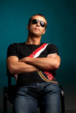 Cool guy wearing sunglasses. Against blue background Royalty Free Stock Photos