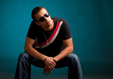 Cool guy wearing sunglasses. Against the blue background Stock Image