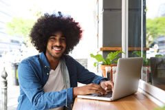 Cool guy working with laptop Royalty Free Stock Photos