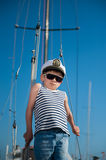Cool handsome little kid captain aboard luxury yacht Stock Photo
