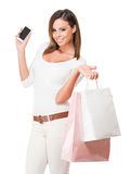 Cool happy shopper. Portrait of a cool happy shopper young brunette woman stock image