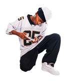 Cool hip-hop young man on white playing Royalty Free Stock Photo