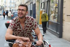 Cool hipster in the city with a bicycle.  royalty free stock photo