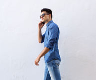 Cool hipster guy walking with mobile phone Stock Photos