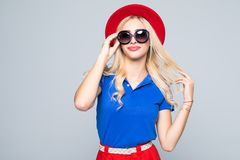 Cool hipster student woman wearing eyewear glasses in color clothes . Caucasian female university student looking at camera smilin. Cool hipster student woman Stock Image